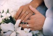 wedding rings and hands holding each other following marriage